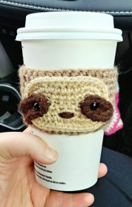 Free Crochet Sloth Cup Cozy Pattern from The Loopy Lamb. An adorable and quick crochet pattern that is great for beginners.