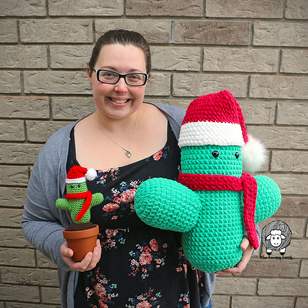 Saint Prickolaus Cactus Cuddler - Free Crochet Pattern from The Loopy Lamb. #Giantamigurumi #amigurumi #amigurumipattern #freecrochetpattern #crochetcactus #christmascactus #christmasamigurumi #bernatblanket
