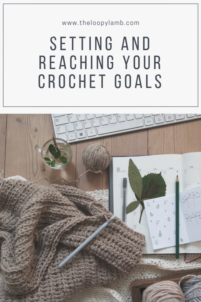 a crochet project laying on top of a planner