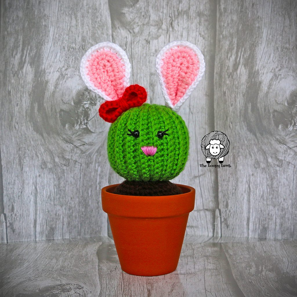 Close up image of Penny The Bunny Cactus in a clay pot made with this free crochet cactus pattern.