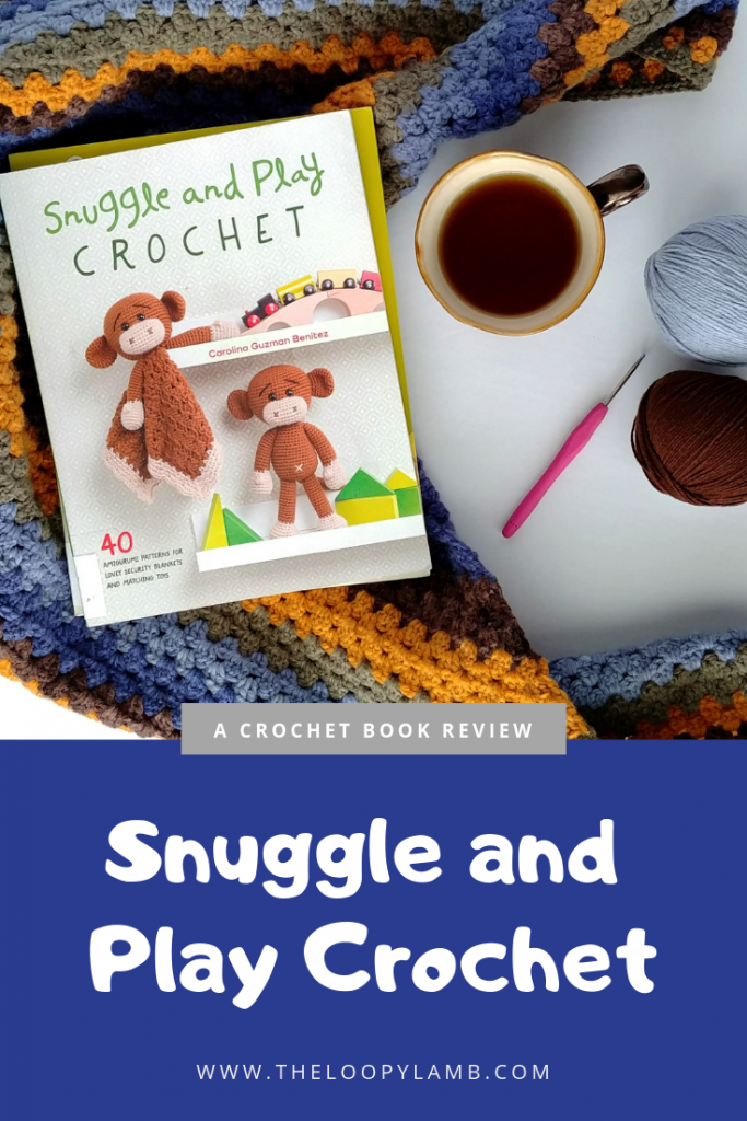 Snuggle and Play Crochet book laying ontop of a crochet project