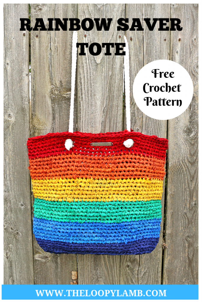 The Rainbow Saver Tote, rainbow crochet bag hanging on a fence post.