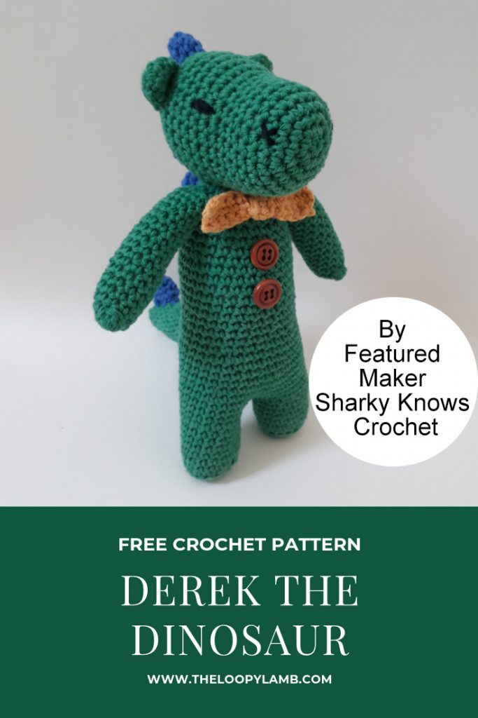 Green crochet dinosaur named Derek the Dinosaur.
