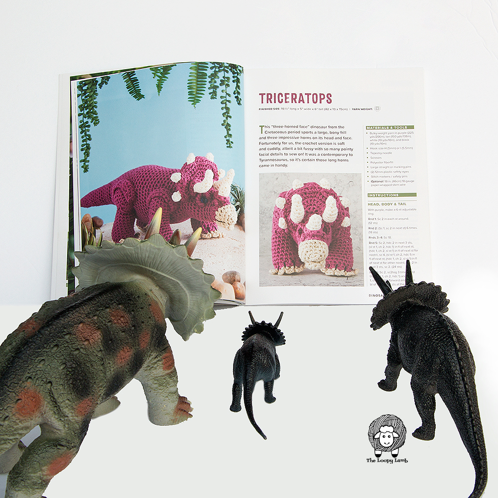 Group of triceratops looking at a crochet triceratops in Dinosaurs to Crochet by Megan Kreiner