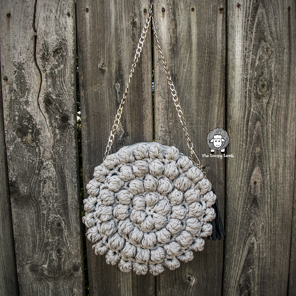 Image of The Bobblelicious Bag against an aged fence.