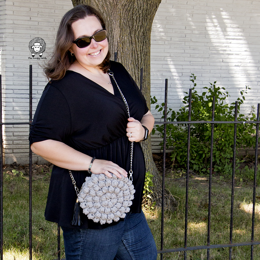 Ashley wearing the Bobblelicious Bag outdoors