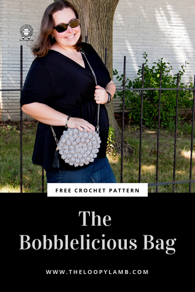 "The Bobblelicious Bag is a free crochet pattern features chunky bobble stitches and a surprise pop of colour. The chain style strap gives it a professional touch that will make your friends wonder ""where did she buy that bag?"".  Check out the free crochet pattern for the Bobblelicious Baf from The Loopy Lamb  #bobblestitch #purse #bobblestitchbag #bag #crochetpattern #freecrochetpattern #freepattern #bobbleliciousbag #Crochetpurse #crochetbag"