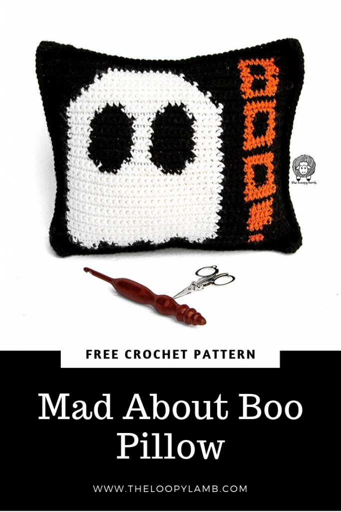 Mad About Boo Crochet Halloween Pillow - Free Crochet Pattern from The Loopy Lamb  This pillow is quick to put together an accessible for anyone that can do a single crochet stitch.  #freecrochetpattern #halloweencrochet #diyhalloweenprojects #halloweenpillow #ghostpillow #boopillow #crochetpillow #crochetdecor #holidaycrochet #crochetpatternfree