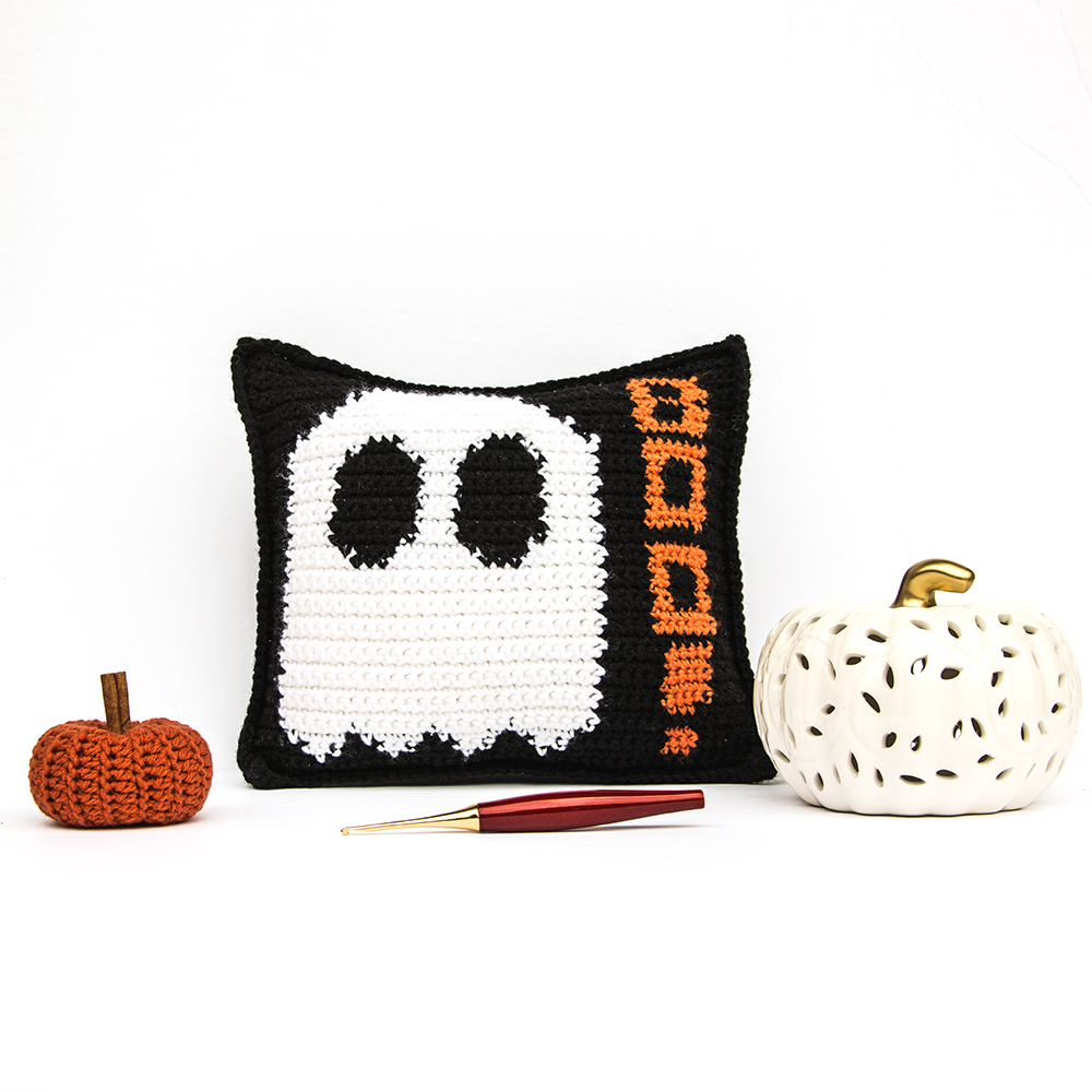 Mad About Boo Crochet Pillow with Furls Odyssey Hook laying in front