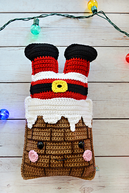 Amigurumi santa legs sticking out of a chimney. free crochet christmas decoration pattern