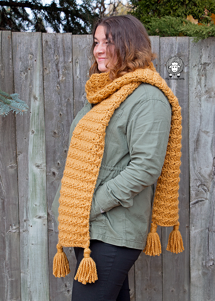 Woman looking off-screen wearing a crochet scarf