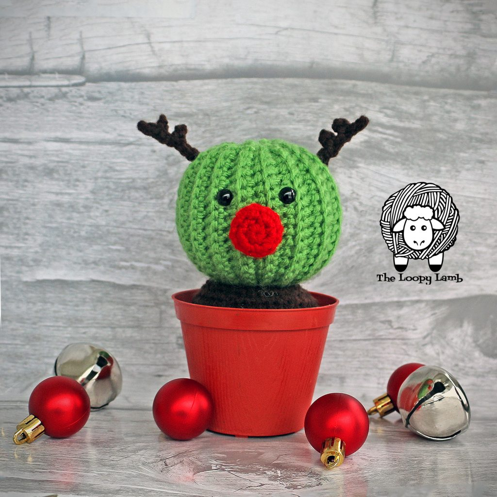 Randy the Cactus Reindeer , crochet cactus in a pot with christmas decorations around him