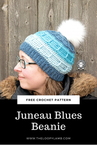 Woman wearing a blue hat made with this free crochet pattern by The Loopy Lamb