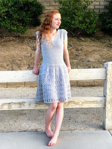 woman wearing the parisian dress made with the free crochet pattern from Desert Blossom Crafts