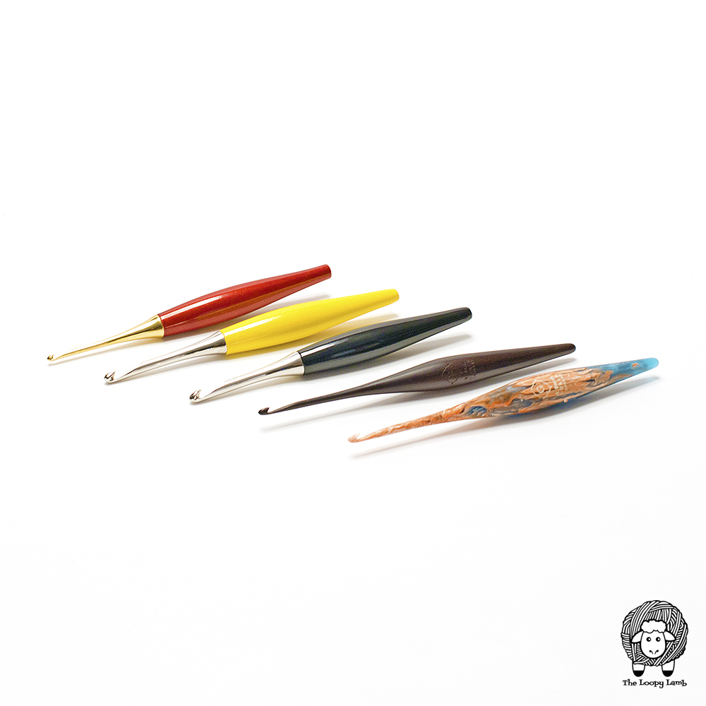 Five differently coloured crochet hooks from the Furls Crochet hook product line.