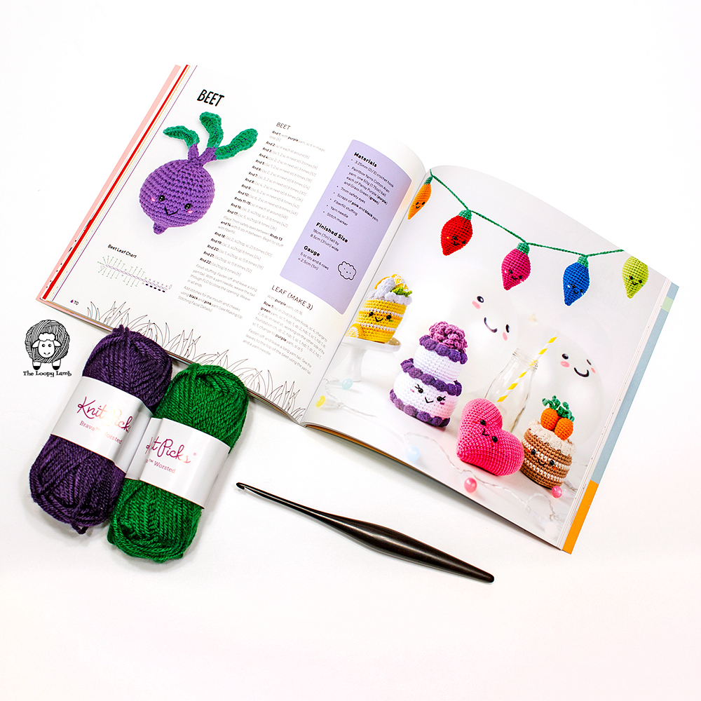 Kawaii Crochet opened to a book featuring images of crochet patterns in the book.