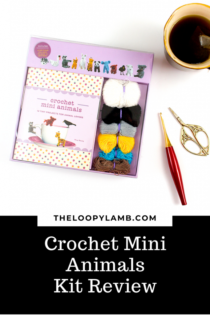 Unopened Crochet Mini Animals Kit next to a tea and crochet accessories