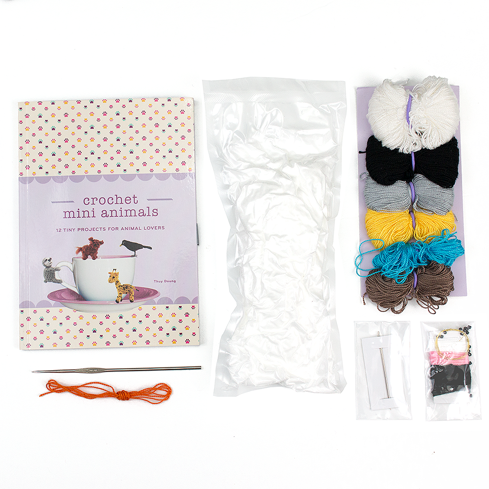 materials included in the crochet mini animals kits lined up next to eachother