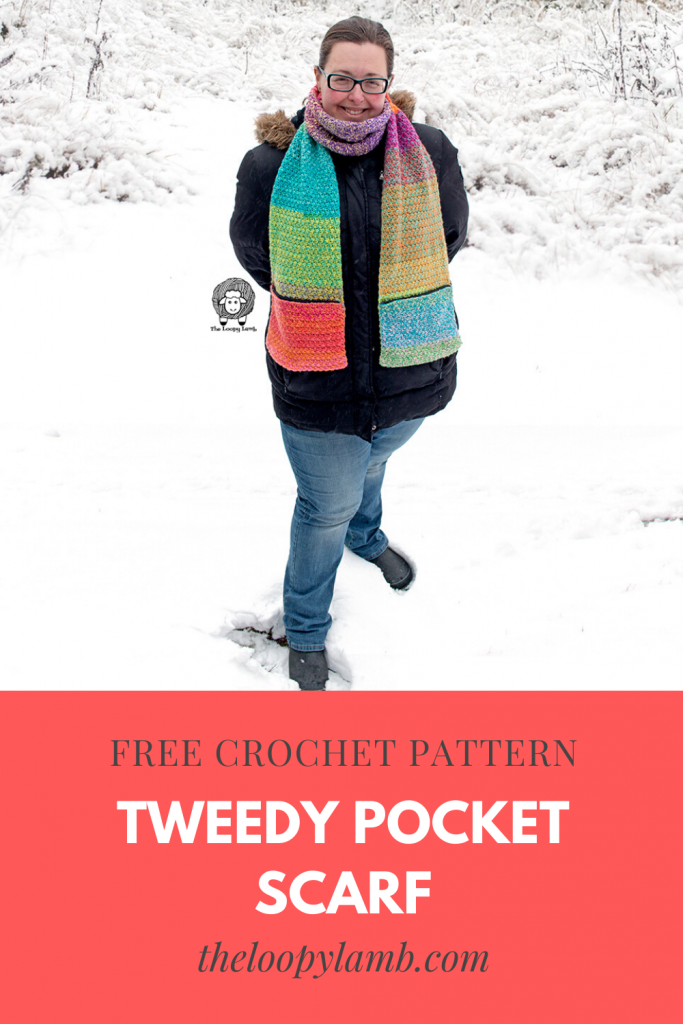 Woman wearing a colourful crochet pocket scarf with zippered pockets.