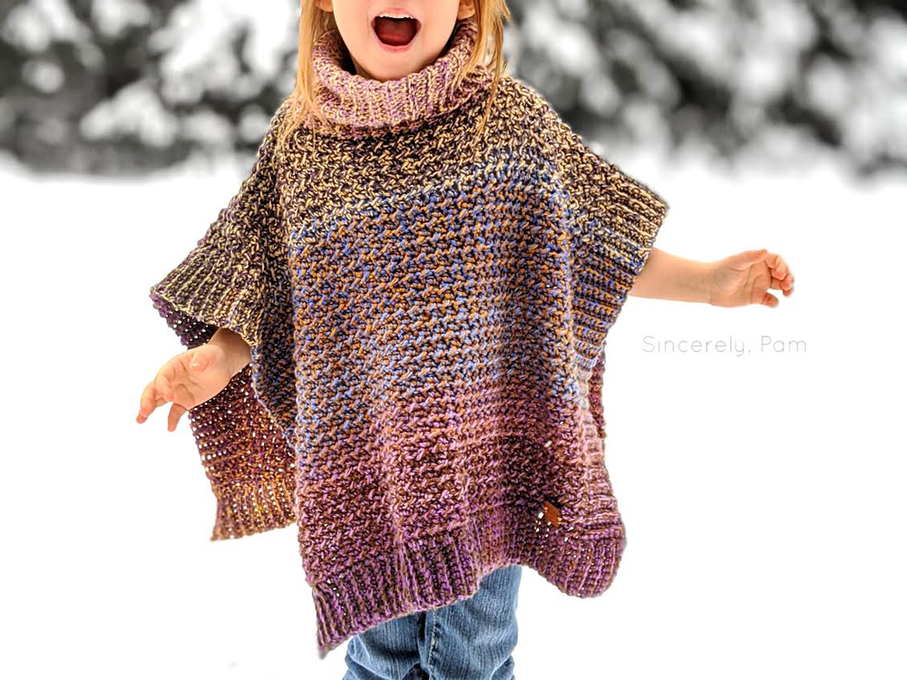 child walking wearing the lucky penny poncho by sincerely pam
