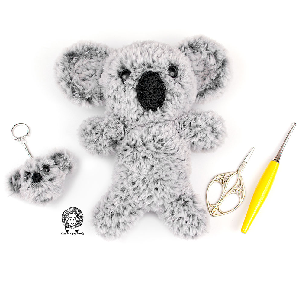 Crochet Koala Keychain and Amigurumi Koala next to crochet accessories