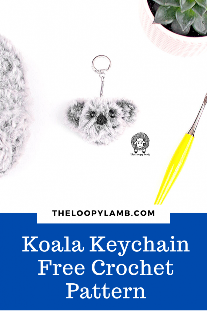 Crochet Koala Keychain next to a yello crochet hook
