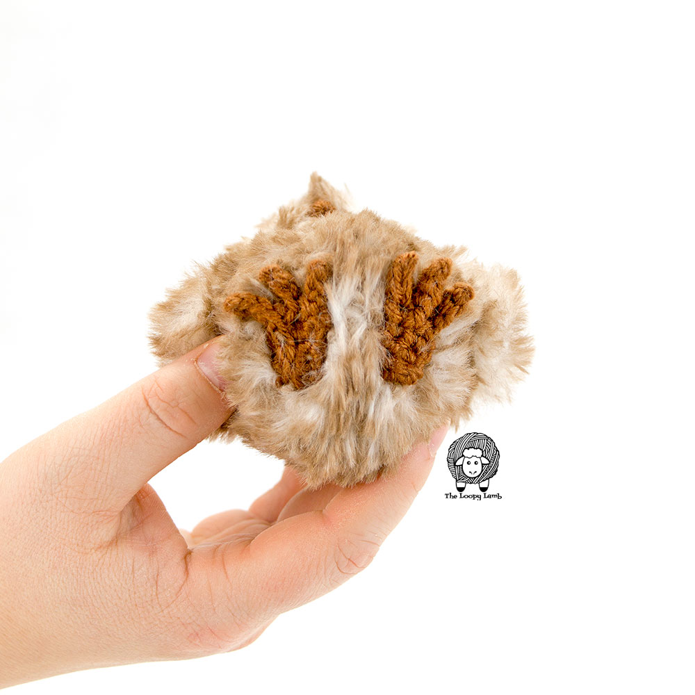 view of the crochet owl feet created in this free crochet pattern and sewn to the bottom of the project.