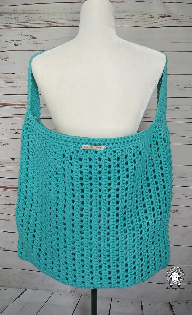 Crochet Tote bag hanging on Mannequin