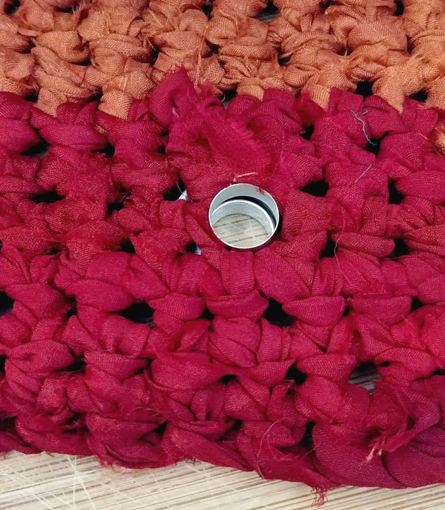 grommet applied to the right side of the crochet tote bag