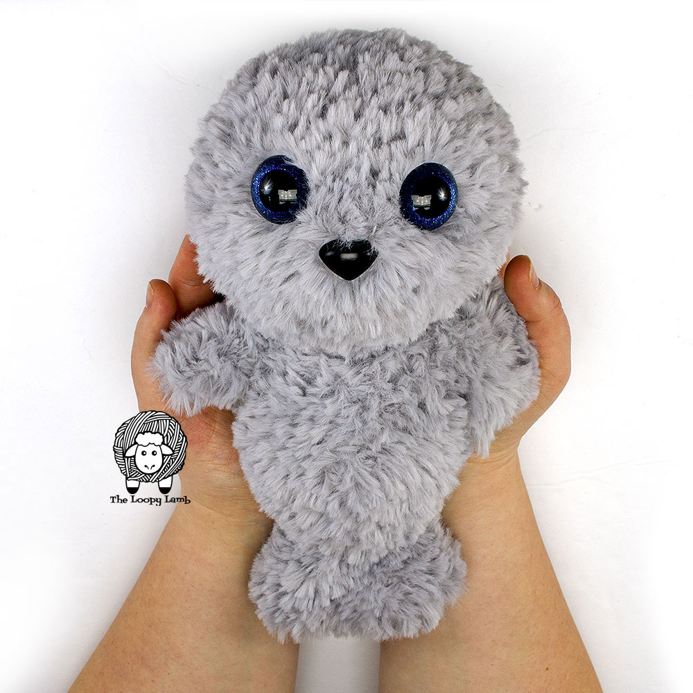 Grey seal with large blue eyes made with this free crochet seal pattern
