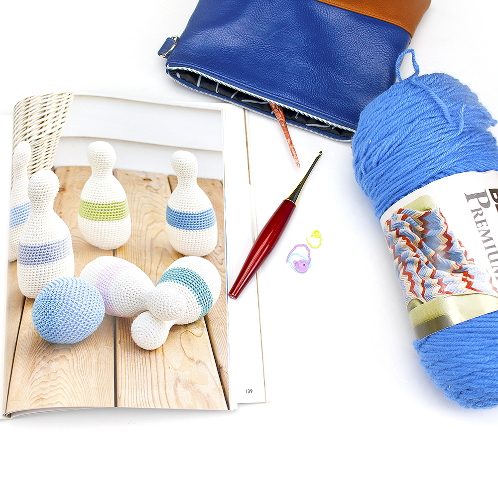 Crochet bowling set image with a furls crochet hook and yarn.