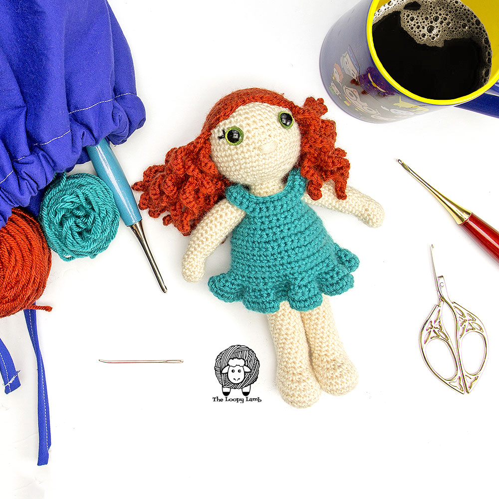 My Dolly Molly Crochet doll with some furls crochet hooks and yarn.