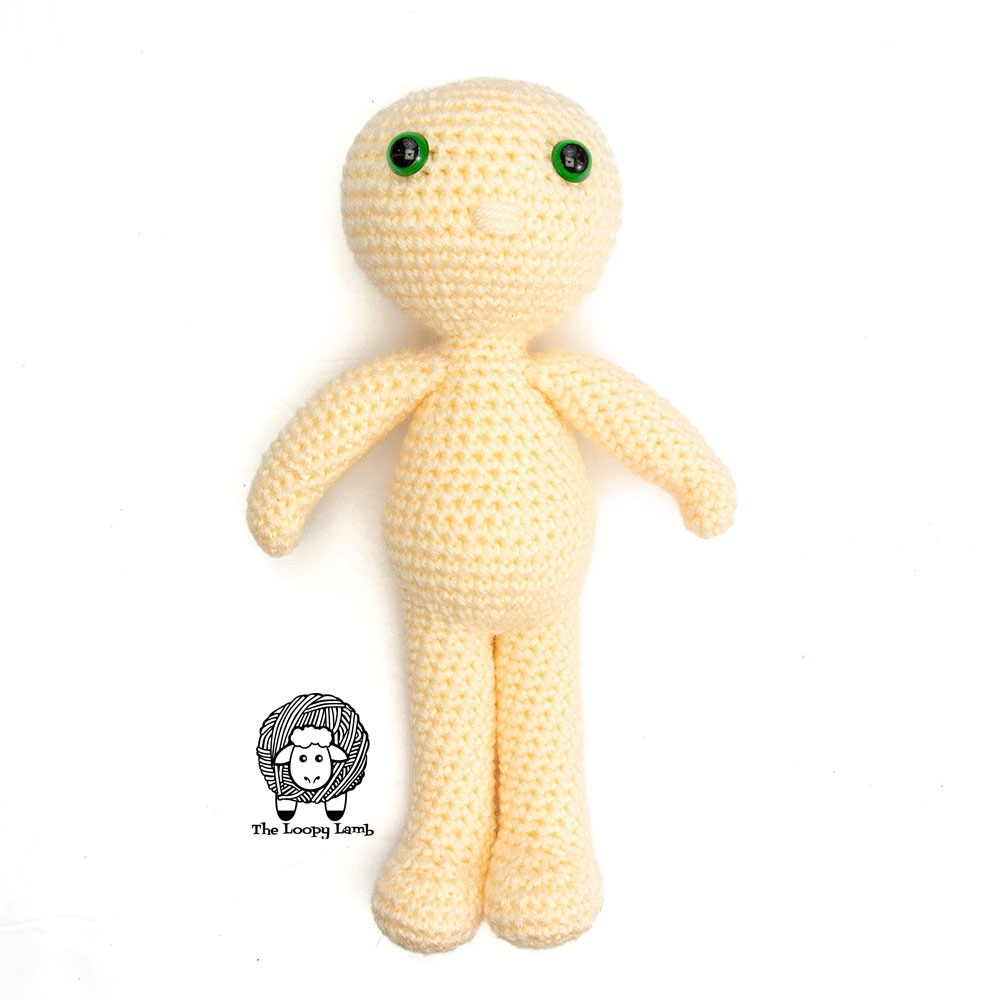 Picture of the completed amigurumi doll body without it's hair and dress.