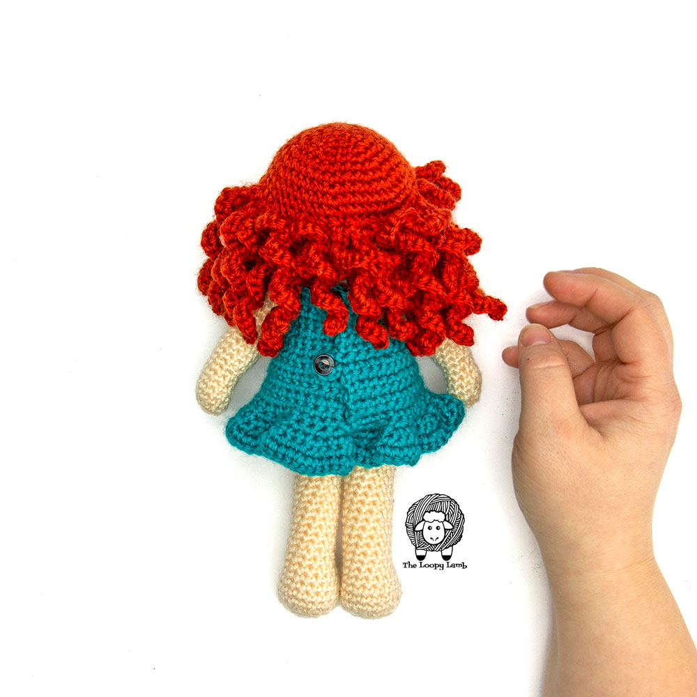 Back view of the crochet doll with clothes made with this free crochet pattern