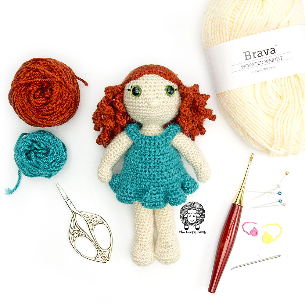 My Dolly Molly with a furls crochet hook and some yarn, made with this crochet doll free pattern.