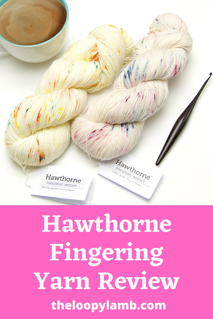 Two hanks of We Crochet Hawthorne Fingering Weight Yarn with a Furls Crochet hook with a text overlay indicating this is a Hawthorne Fingering Yarn Review.
