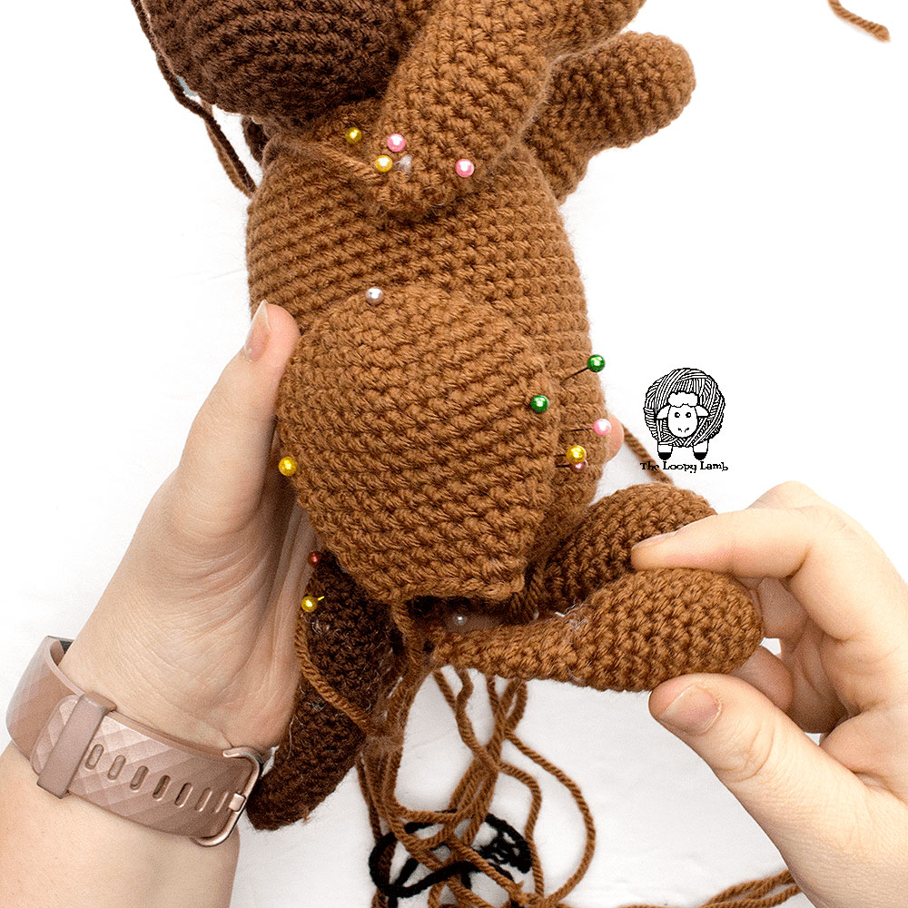 Step one of the leg application process for this free crochet dog pattern
