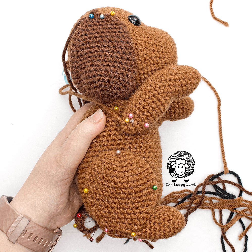 Step two of the leg application process for this free crochet dog pattern