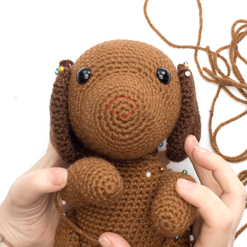 Close up image of the embroidered nose on the amigurumi dog