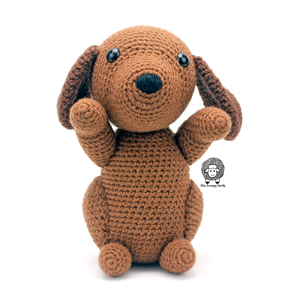 Brown amigurumi dog standing up and begging for a treat