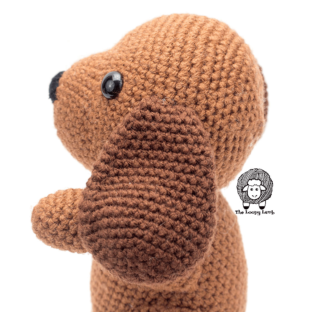 Close up image of the dark brown ear on the dog toy made with this free crochet dog pattern.