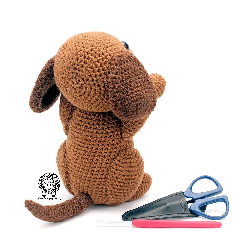 Back view of the amigurumi dog made with this free crochet pattern and some Clover USA tools.