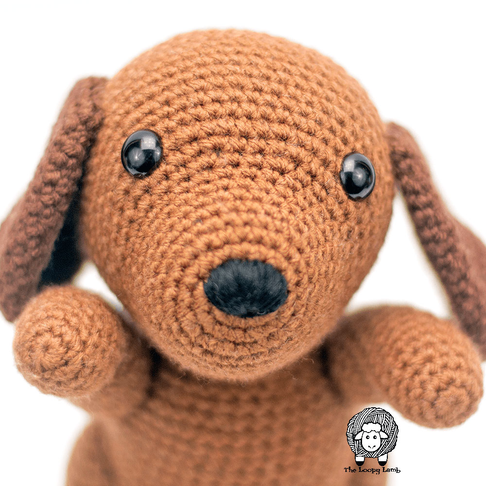 Close up image of the nose and face of the crochet toy made with this free crochet dog pattern.