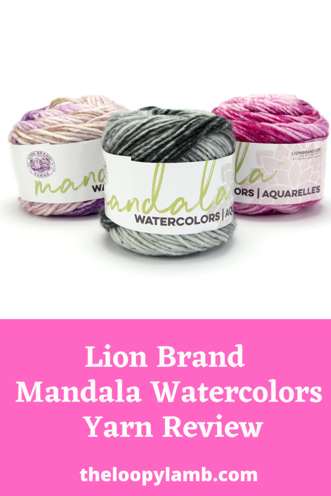 three cakes of Lion Brand Mandala Watercolors yarn side by side.