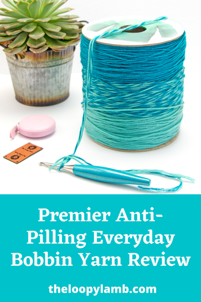 close up image of Premier Anit-Pilling Everyday Bobbin Yarn and a furls crochet hook.