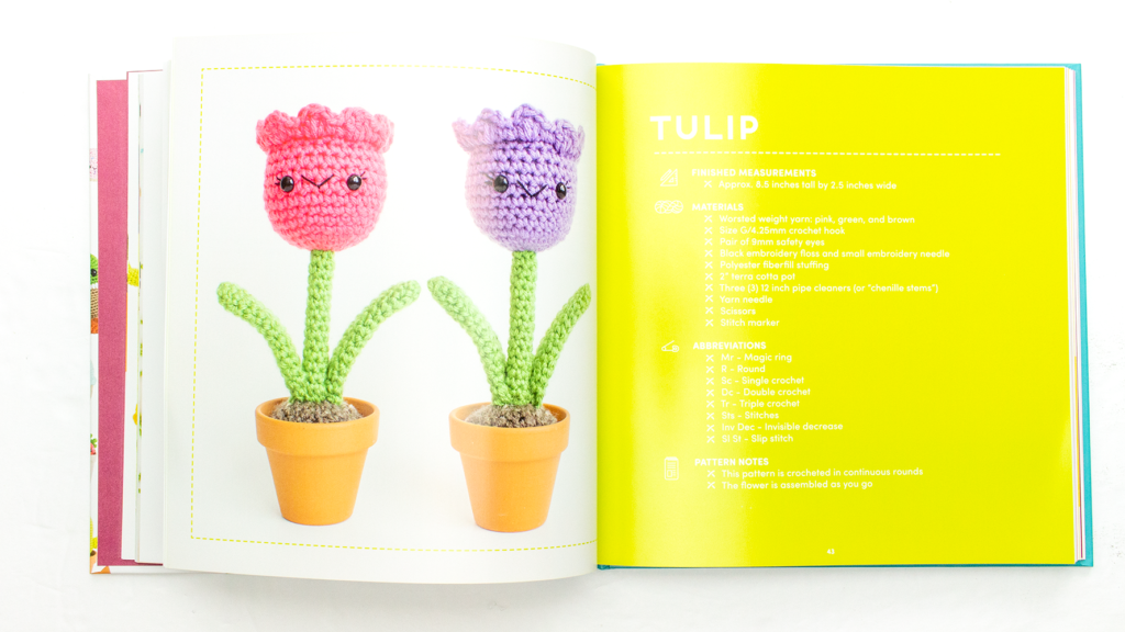 crochet tulips in pink and purple illustrated inside this crochet book