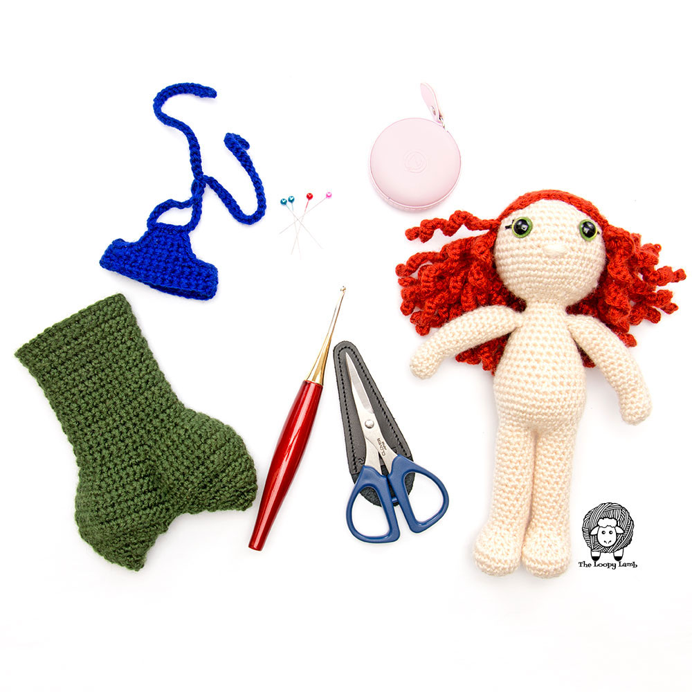 Crochet doll with a removeable mermaid tail outfit
