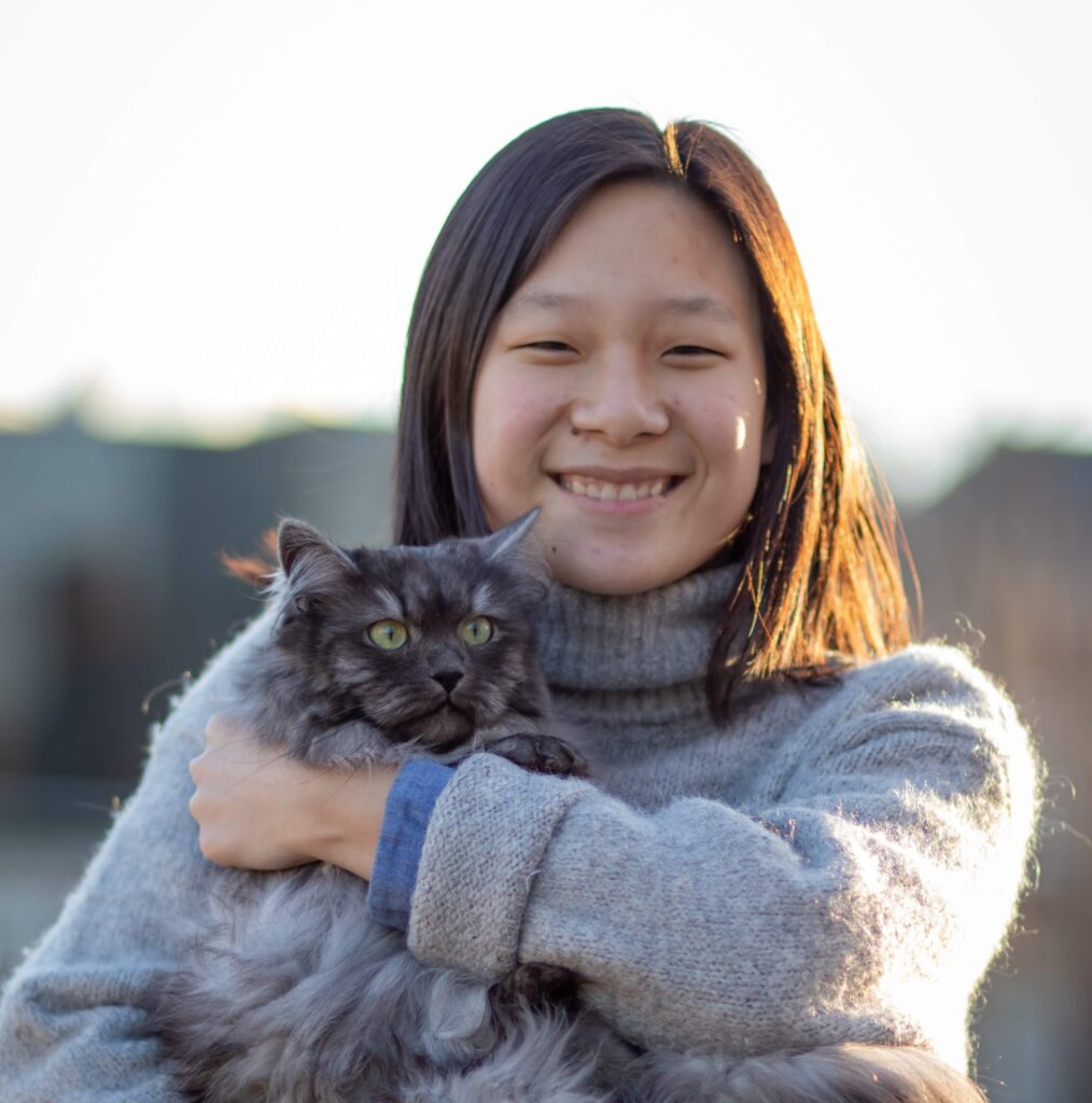 Julia Chiang of Craftings of Joules holding a cat
