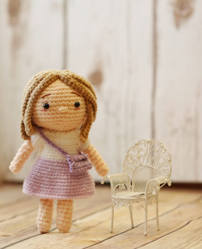 Voilet the schoolgirl doll made with this free crochet doll pattern