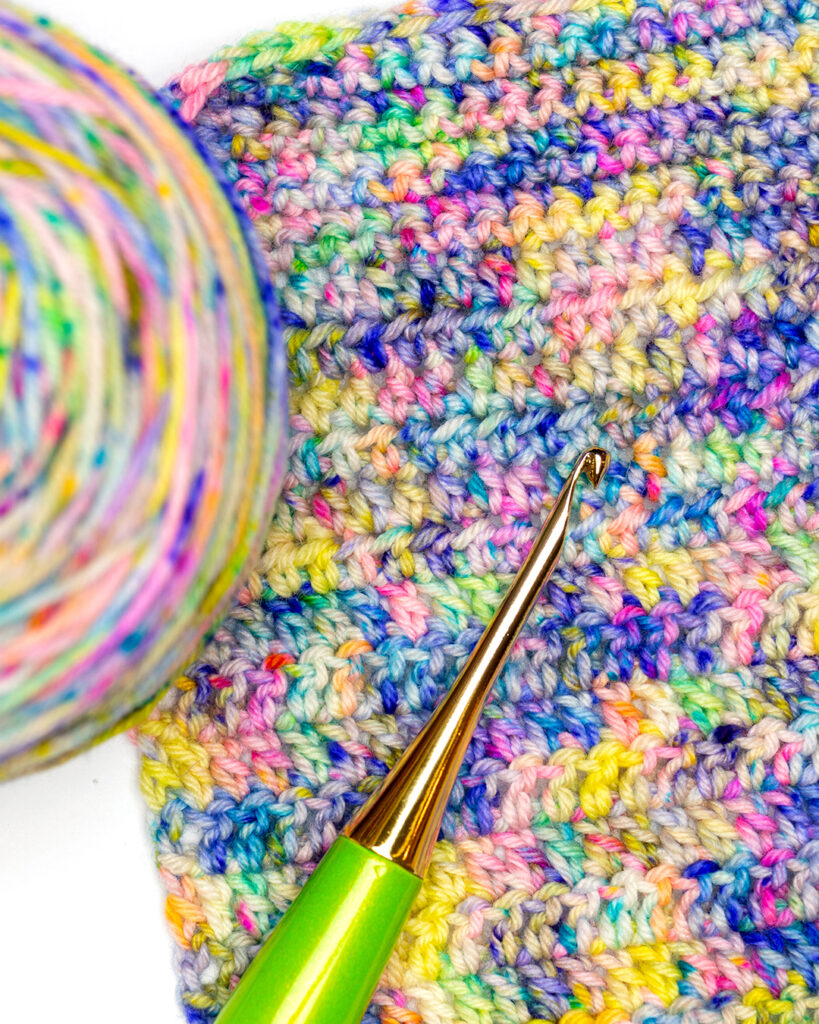 close up image of crochet swatch done in opal oz sirocco yarn from Rhichard Devrieze Yarns